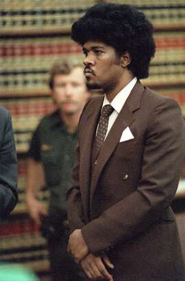 **FOR USE AS DESIRED WITH COOPER EXECUTION STORIES-FILE ** Convicted murder Kevin Cooper stands before a San Diego judge in this May 1985 file photo when he was sentenced to death for the 1983 slayings of three Chino Hills, Calif, family members and a friend. Cooper is scheduled to die by lethal injection Tuesday, Feb. 10 in California's San Quentin prison. (AP Photo/San Diego Union Tribune, Dave Siccardi, File)  Kevin Cooper, sentenced to die 12:01 a.m. Tuesday, was convicted of murdering four people in 1983.      Ran on: 12-13-2010 Kevin Cooper during his sentencing hearing in 1985.