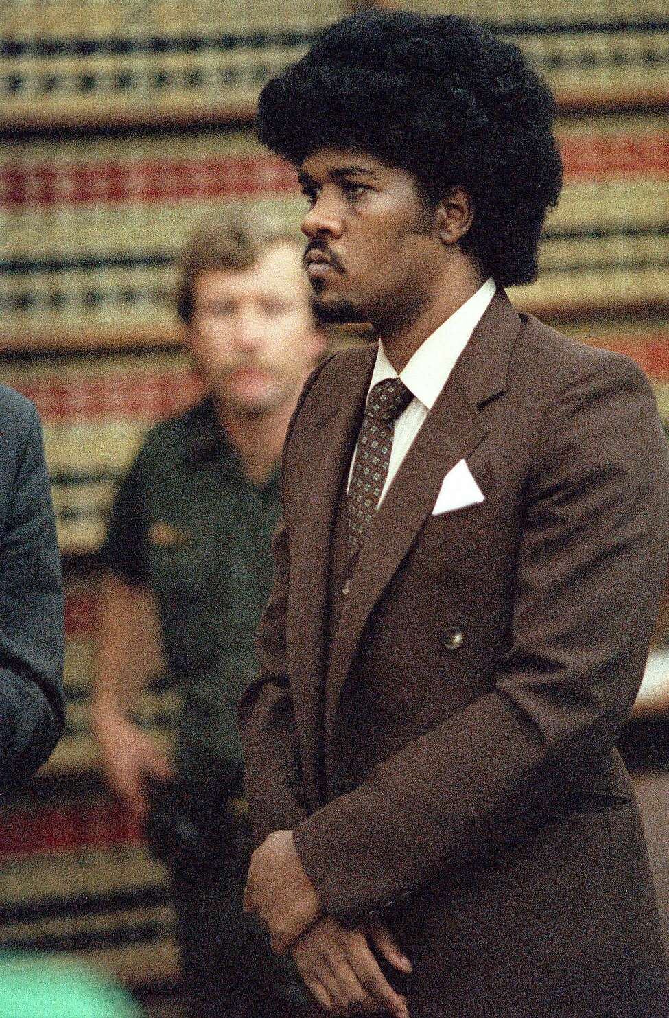 Convicted murder Kevin Cooper stands before a San Diego judge in this May 1985 file photo when he was sentenced to death for the 1983 slayings of three Chino Hills, Calif, family members and a friend.