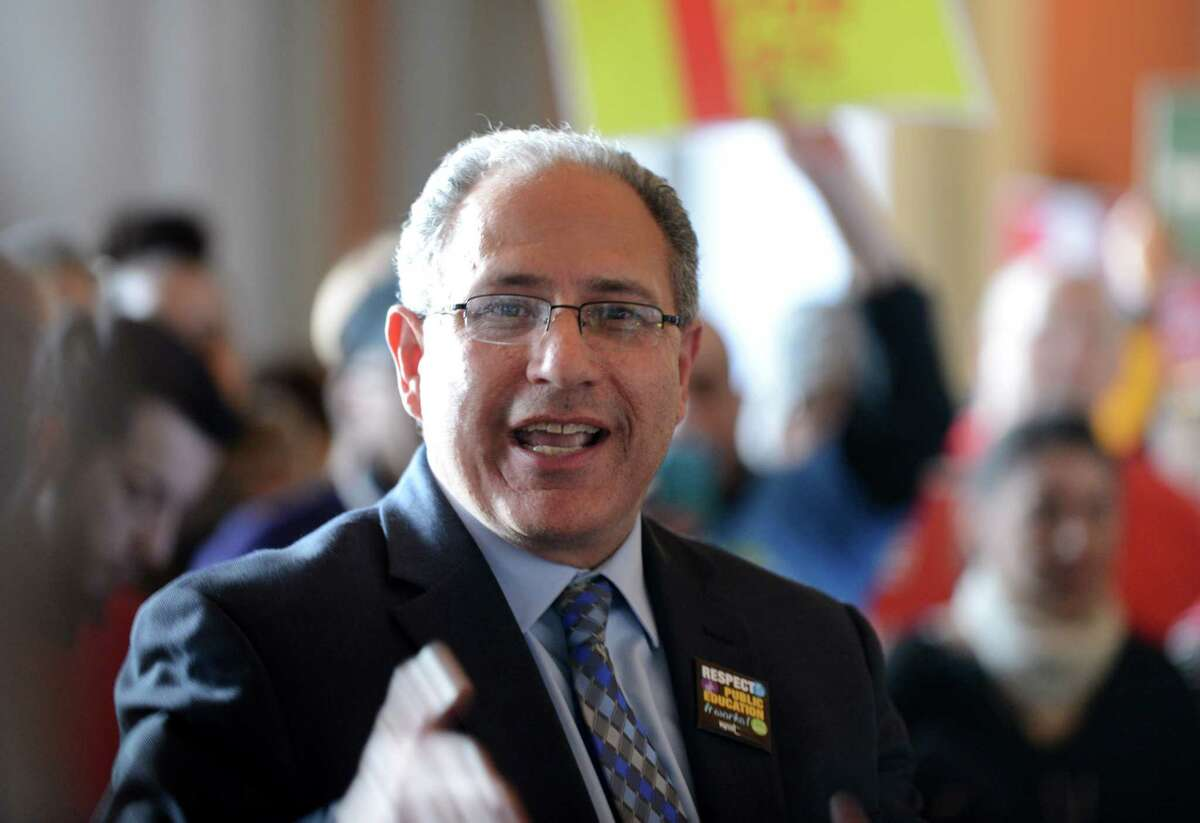 NYSUT Vice President Andrew Pallotta speaks to minimum wage advocates who rallied at the Capitol in support of increasing state?'s wage to $15 per hour Monday, March 23, 2015, in Albany, N.Y. (Will Waldron/Times Union)