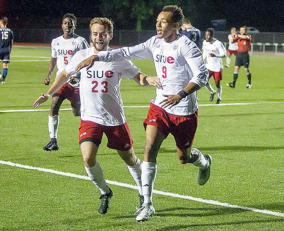 SIUE's TC Hull, left and Devyn Jambga celebrate during a game last season against Butler. The Cougars will open their 2018 season Aug. 24 at Memphis. The home opener is set for Aug. 28 against UMKC. Photo:       SIUE Athletics