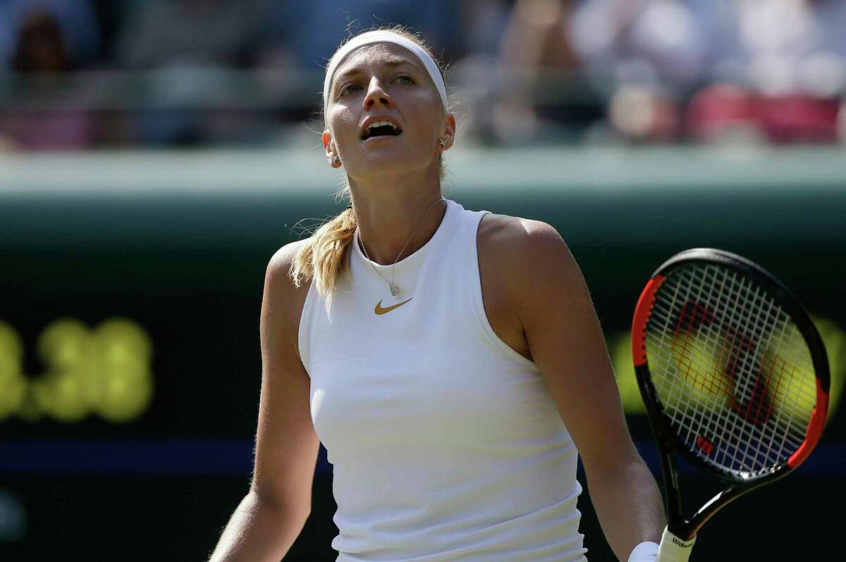 Petra Kvitova of the Czech Republic loses a point to Aliaksandra Sasnovich of Belarus during their women's singles match on the second day at the Wimbledon Tennis Championships in London, Tuesday July 3, 2018. (AP Photo/Tim Ireland)