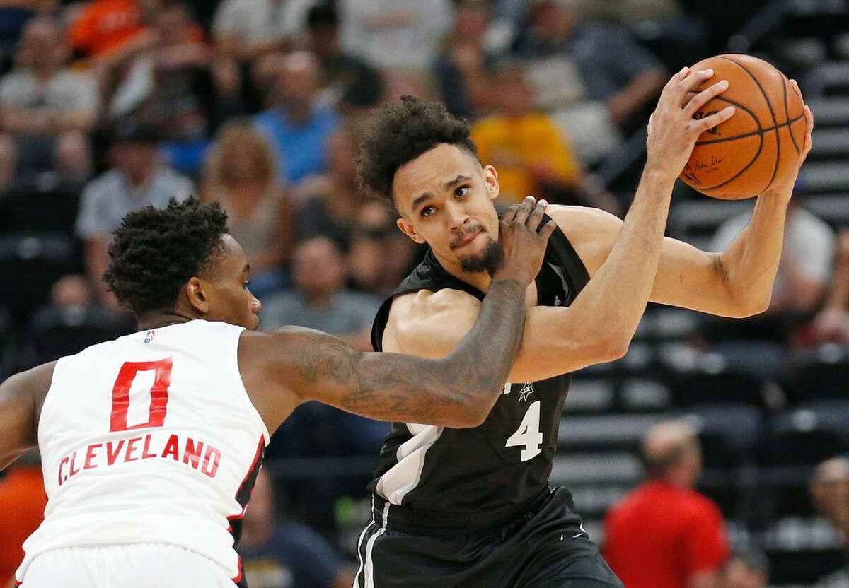Atlanta Hawks guard Antonius Cleveland (0) guards San Antonio Spurs guard Derrick White (4) during the second half of an NBA summer league basketball game Tuesday, July 3, 2018, in Salt Lake City. (AP Photo/Rick Bowmer)