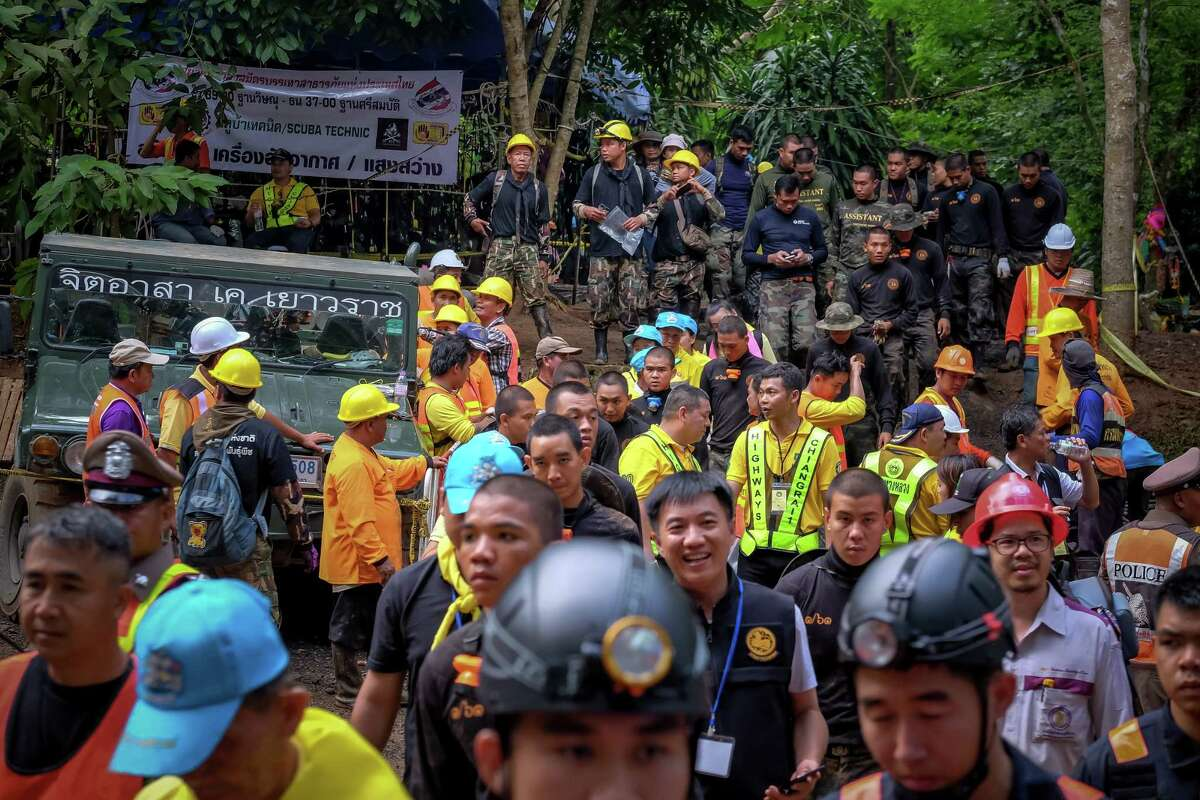 CHIANG RAI, THAILAND - JULY 3: Hundreds of rescuers & equipments are still being sent inside Tham Luang Nang Non cave to continue the rescue operation after the 12 boys and their soccer coach have been found alive in the cave where they've been missing for over a week after monsoon rains blocked the main entrance on July 03, 2018 in Chiang Rai, Thailand. Chiang Rai governor Narongsak Osatanakorn announced on Monday that the boys, aged 11 to 16, and their 25-year-old coach were being rescued from Tham Luang Nang Non cave after they were discovered by naval special forces and the challenge now will be to extract the party safely. (Photo by Linh Pham/Getty Images)