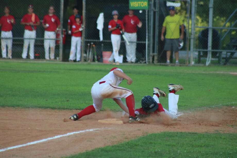 League City White third baseman Alek Kowalczyk applies the tag on a League City Red runner during Game 1 action Monday night. In addition to Red's offense not driving in any runs, they had two players tagged out at third base, which proved costly in the one-run defeat. Photo: Robert Avery
