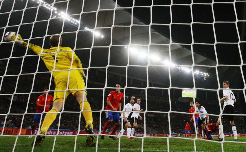 DURBAN, SOUTH AFRICA - JULY 07: Carles Puyol of Spain scores the opening goal past Manuel Neuer of Germany during the 2010 FIFA World Cup South Africa Semi Final match between Germany and Spain at Durban Stadium on July 7, 2010 in Durban, South Africa. (Photo by Joern Pollex/Getty Images) *** Local Caption *** Carles Puyol;Manuel Neuer