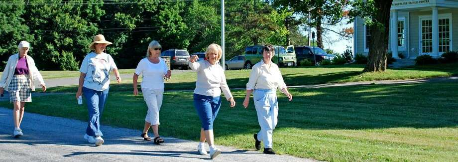 SPECTRUM/Members of the walking group at the Bridgewater Senior Center, from left to right, Madeline Gale, Joyce Rennestad, center executive director Marilyn Curtin, Anny Tyman and Nancy Stuart, head out on their morning walk, starting at the center on Hut Hill Road, July 1, 2010. Photo: Deborah Rose / The News-Times