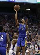 Golden State Warriors rookie guard Jacob Evans III shoots next to Sacramento Kings forward Nigel Hayes during the first half of an NBA summer league basketball game Tuesday, July 3, 2018, in Sacramento, Calif. (AP Photo/Rich Pedroncelli)