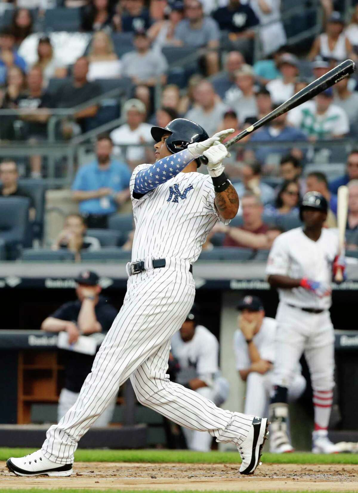 New York Yankees' Aaron Hicks watches his two-run home run during the first inning of a baseball game against the Atlanta Braves on Tuesday, July 3, 2018, in New York. (AP Photo/Frank Franklin II)