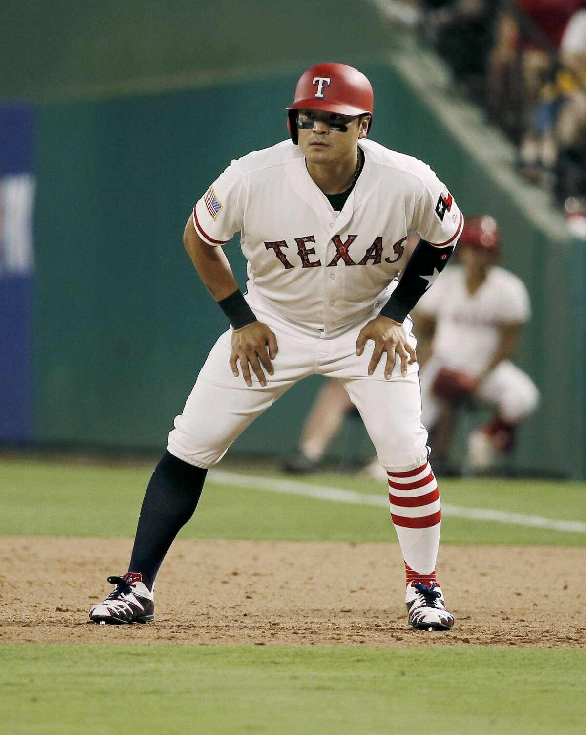 Texas Rangers' Shin-Soo Choo (17) leads off of first during the fifth inning of a baseball game against the Houston Astros, Tuesday, July 3, 2018, in Arlington, Texas. Houston won 5-3. (AP Photo/Brandon Wade)