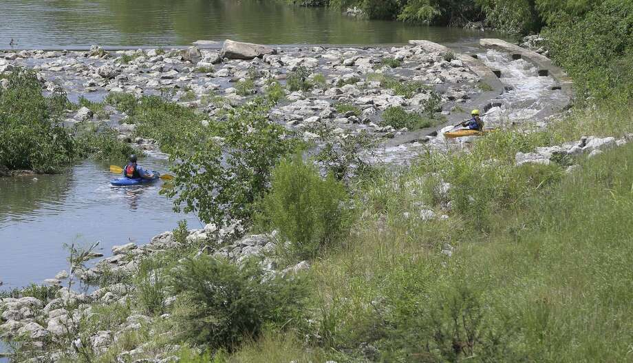 Kayakers take advantage of a brief storm that brought a stronger flow to the San Antonio River's Mission Reach in May 21. May was the third driest on record. June was the 24th driest. Photo: William Luther /San Antonio Express-News / © 2017 San Antonio Express-News