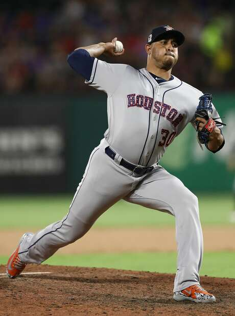 ARLINGTON, TX - JULY 03:  Hector Rondon #30 of the Houston Astros throws against the Texas Rangers at Globe Life Park in Arlington on July 3, 2018 in Arlington, Texas.  (Photo by Ronald Martinez/Getty Images) Photo: Ronald Martinez/Getty Images