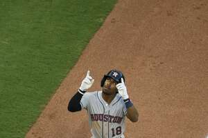 Houston Astros' Tony Kemp (18) points skyward after hitting a two-run home run during the third inning of a baseball game against the Texas Rangers, Tuesday, July 3, 2018, in Arlington, Texas. (AP Photo/Brandon Wade)