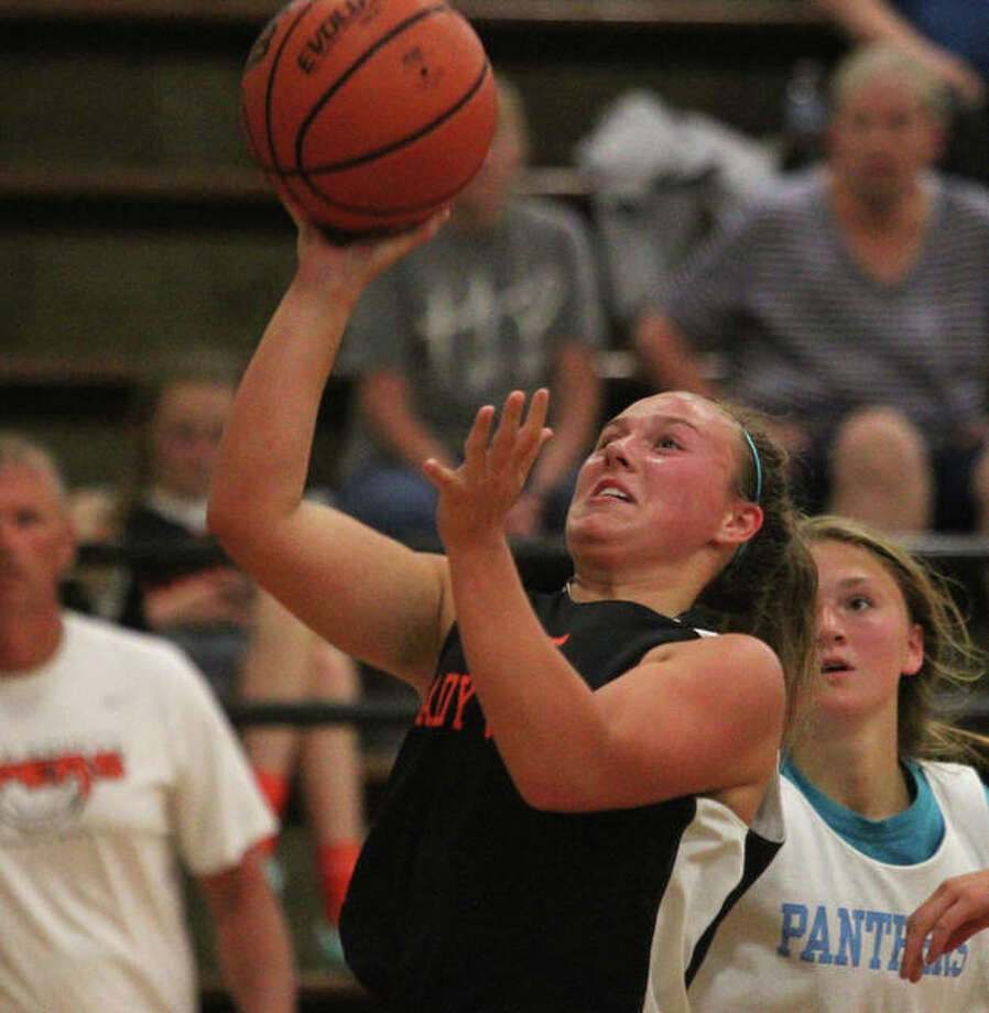 South County's Caitlyn Braker flies to the basket during a game in the Waverly Summer League.