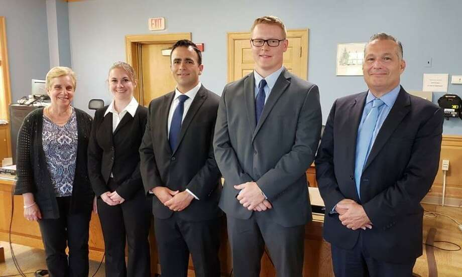Trumbull hired three new police officers. Pictured from left to right: Trumbull First Selectman Tesoro, Caitlin Murphy, James Kassimis, Matthew O'Connor and Chief Lombardo Photo: Contributed Photo /