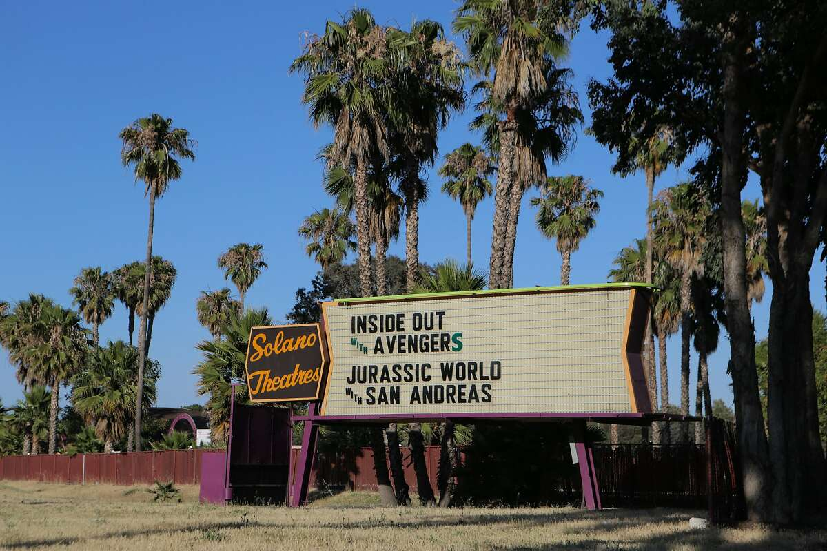 A sign outside the West Wind Solano 2 Drive-In movie theatre in Concord, California, advertises the night's films on Thursday, June 25, 2015. Drive-In movie theaters are a dying breed in the 21st century.