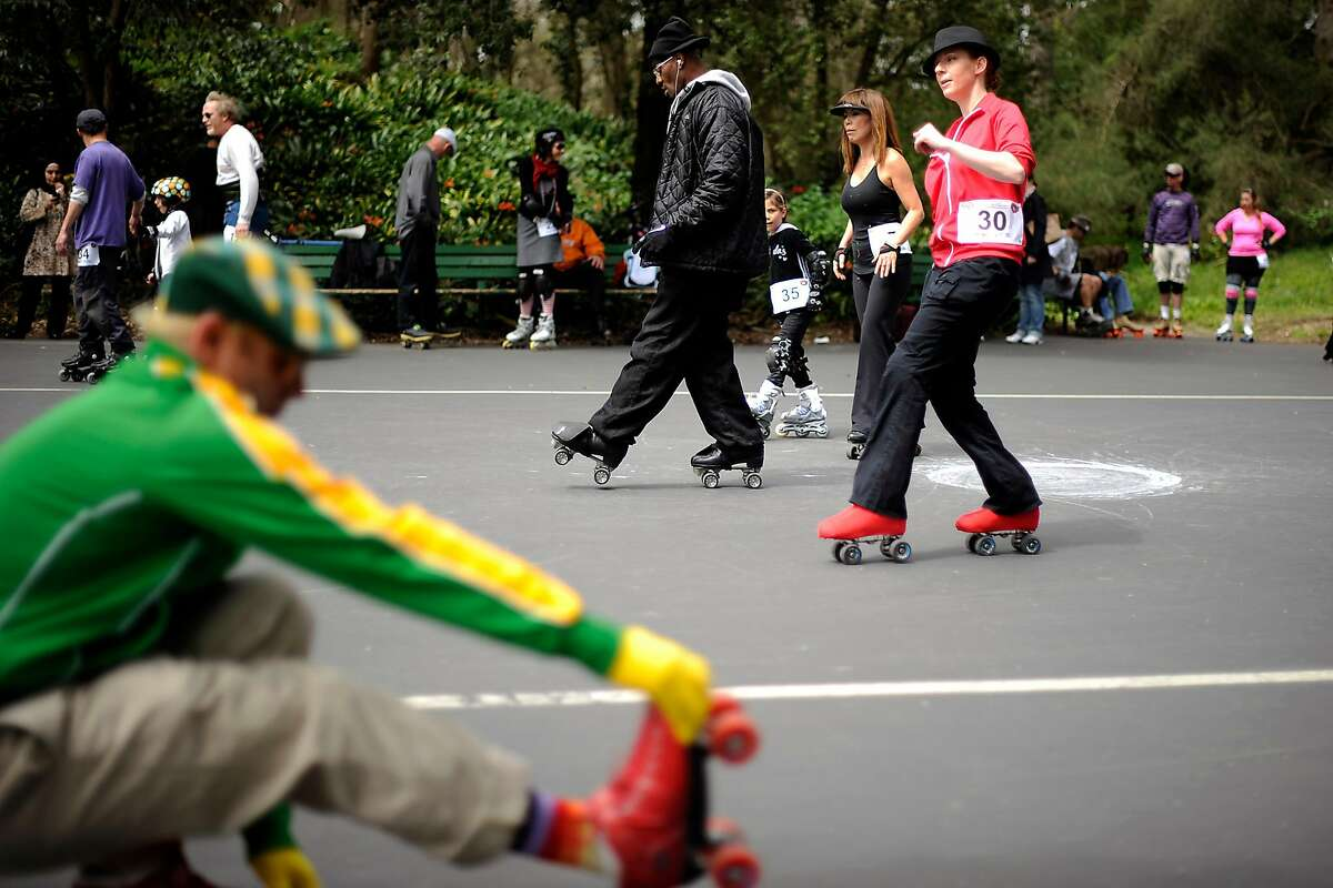 People dance around in the roller skating area at 6th Ave. and JFK Dr. California Outdoor Rollersports Association attempted to break a world record for longest roller skate line in Golden Gate Park Sunday April 15th 2012