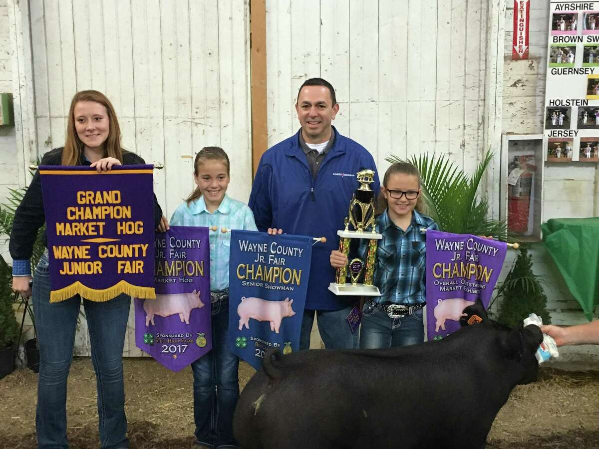 Kinder Morgan's Allen Fore purchased the grand champion hog at the Wayne County Fair, one of several the company visited as it built support for its Utopia Pipeline in Ohio.