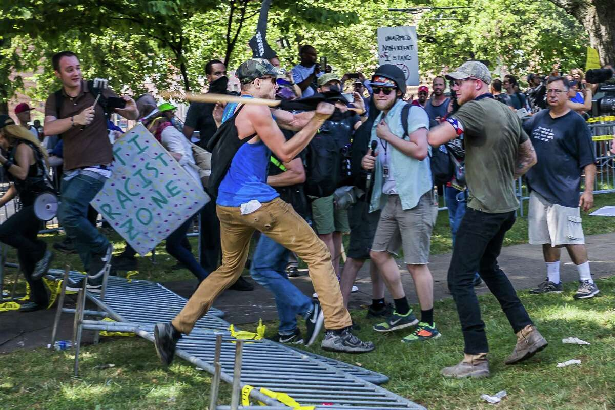 """On Saturday, Aug. 12, 2017, a veritable who's who of white supremacist groups clashed with hundreds of counter-protesters during the """"Unite The Right"""" rally in Charlottesville, Va. The National Park Service announced Wednesday it had approved a """"white civil rights"""" rally for Lafayette Square the weekend of Aug. 11-12. (Michael Nigro/Pacific Press/Zuma Press/TNS)"""