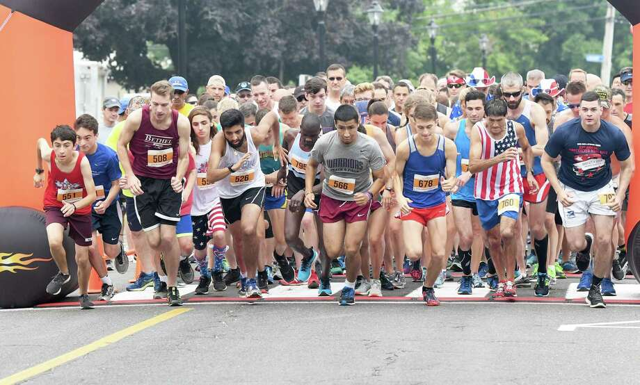 The start of the the 53rd Annual John Demille Firecracker 8K Road Race in Bethel, July 4, 2018. Photo: Krista Benson / The News-Times Freelance