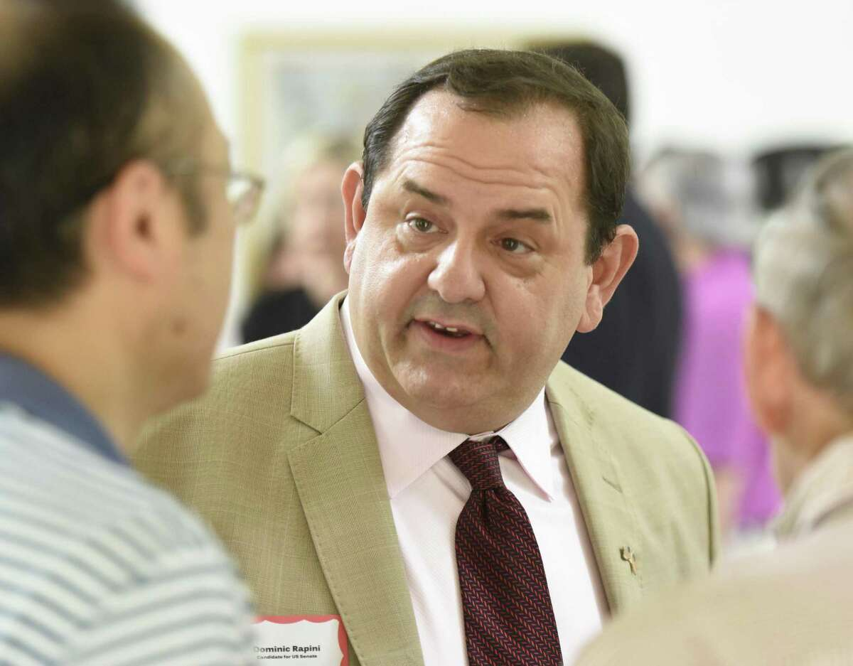 Republican U.S. Senate candidate Dominic Rapini chats at the Wilton Republican Committee's Save Our State fundraiser luncheon at the Old Town Hall in Wilton June 10.