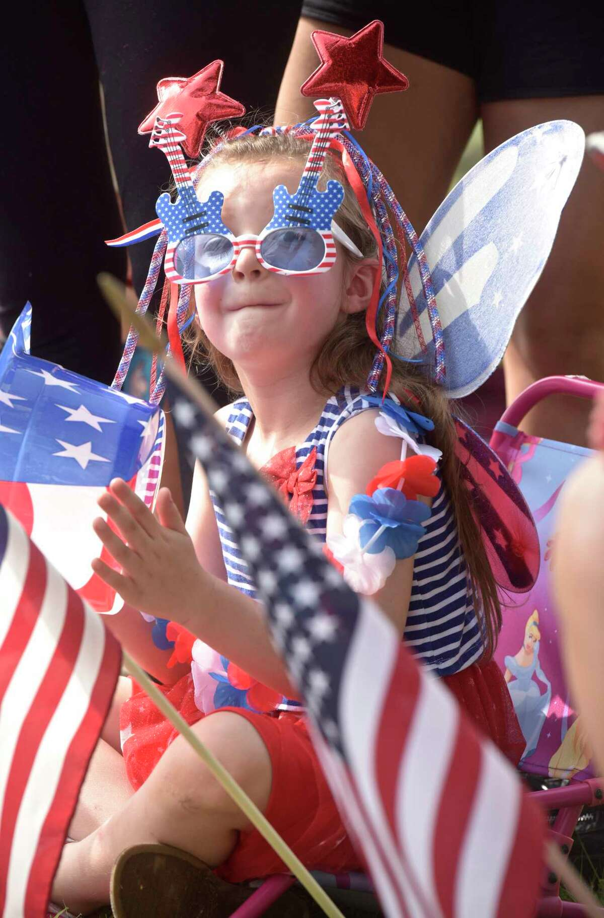 Cece Curatilo, 6, of New Fairfield, is all red, white & blue as she watches the annual Independence Day Parade hosted by the New Fairfield Lions Club. Wednesday, July 4, 2018, in New Fairfield, Conn.