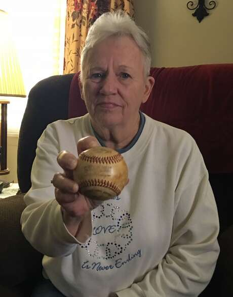 Jean Zwerneman clutches the baseball that broke her late husband's nose during a game in the Astrodome - a foul ball off the bat of the Astros' Cesar Cedeno. Photo: Brent Zwerneman/Houston Chronicle