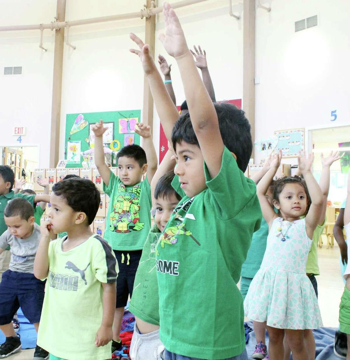 """Children at the CLC Palmer's Hill location practice yoga as part of """"Calm Day"""" on June 29, 2018. The activity was part of the RULER program from Yale which teaches students to recognize and regulate their emotions. The first early childhood version of the RULER program has been used at CLC for the past five years."""