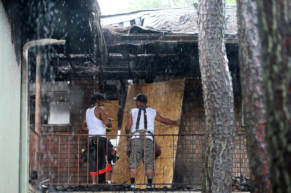 Workers board up the entrance to an apartment after a fire at the Arthur Square Apartments in Port Arthur. Three children died from smoke inhalation. Photo taken Wednesday 7/4/18 Ryan Pelham/The Enterprise