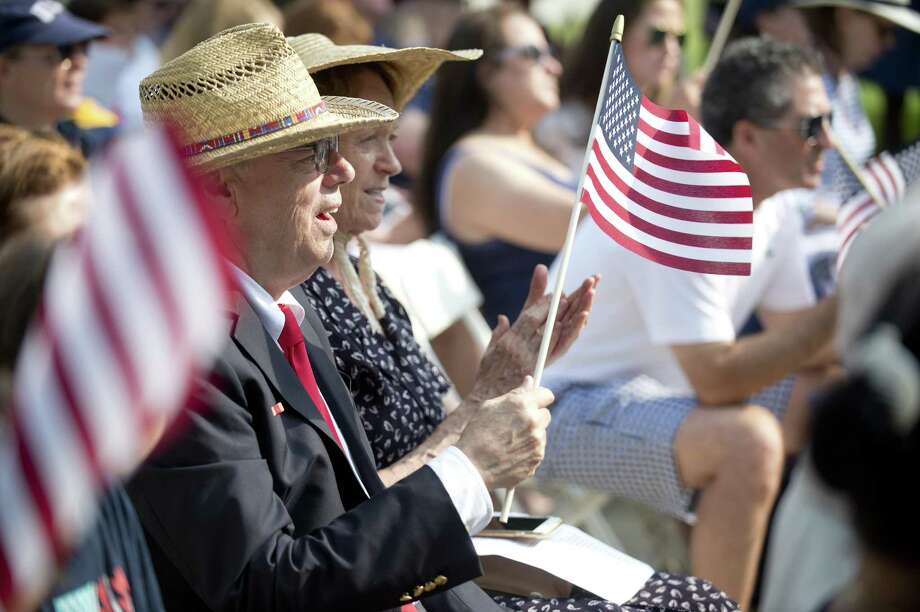 Mike Finlay waves a flag during the Greenwich July 4 ceremony at Town Hall held by the Independence Day Association on July 4, 2018. Photo: Lindsay Perry / For Hearst Connecticut Media / Greenwich Time Freelance