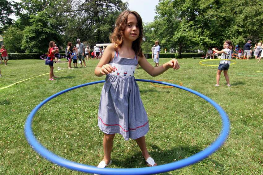 Graceanne Vail 8, of Fairfield, takes part in a hula hoop contest during Pequot Library's annual 4th of July Bike Parade and Lawn Games event in Southport, Conn., on Wednesday July 4, 2018. Chris Frantz, drummer for the Talking Heads, started the event by leading the bike parade from Southport Village on a vintage drum. Afterwards, children took part in a variety of lawn games like the hula hoop contest, sack races, a bubble blowing contest, face painting and many other games.