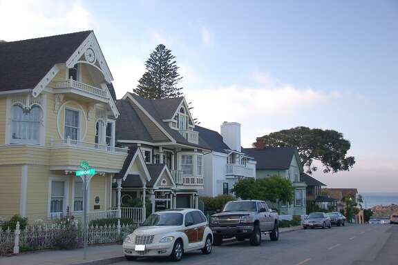 Travel Pacific Grove -- The sun starts to set over the quaint Victorian houses and cottages in Pacific Grove, CA. Credit: Jeanne Cooper / The Chronicle 2007