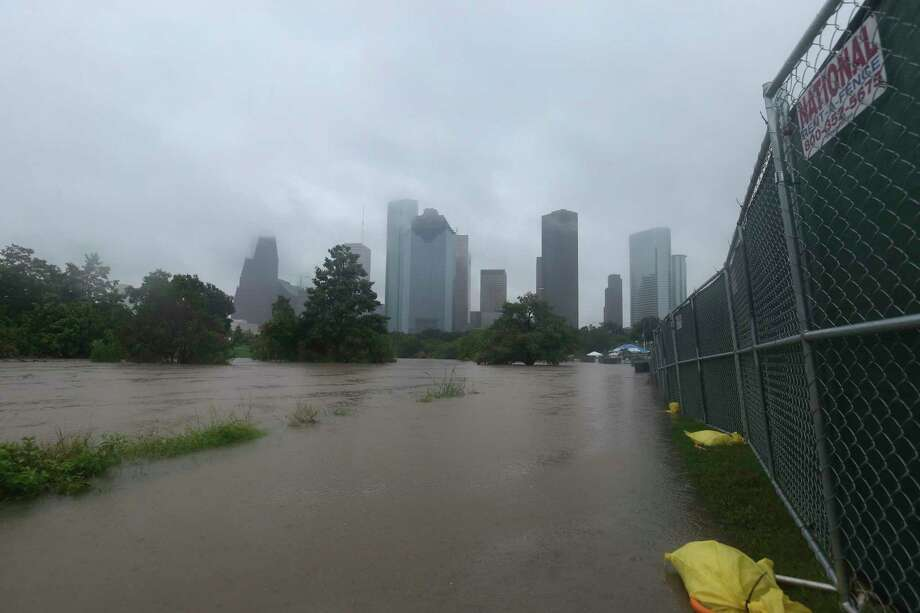 The Buffalo Bayou floodwater rises to level with the fences for the Freedom Over Texas concert after heavy rainfall  on Wednesday, July 4, 2018, in Houston. The concert was cancelled after Buffalo Bayou flooded and compromised the Eleanor Tinsley Park. Photo: Yi-Chin Lee, Houston Chronicle / © 2018 Houston Chronicle
