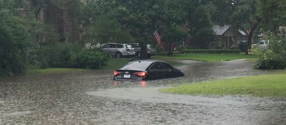 A car stuck in floodwaters at Elm Street and the Loop 610 South feeder.