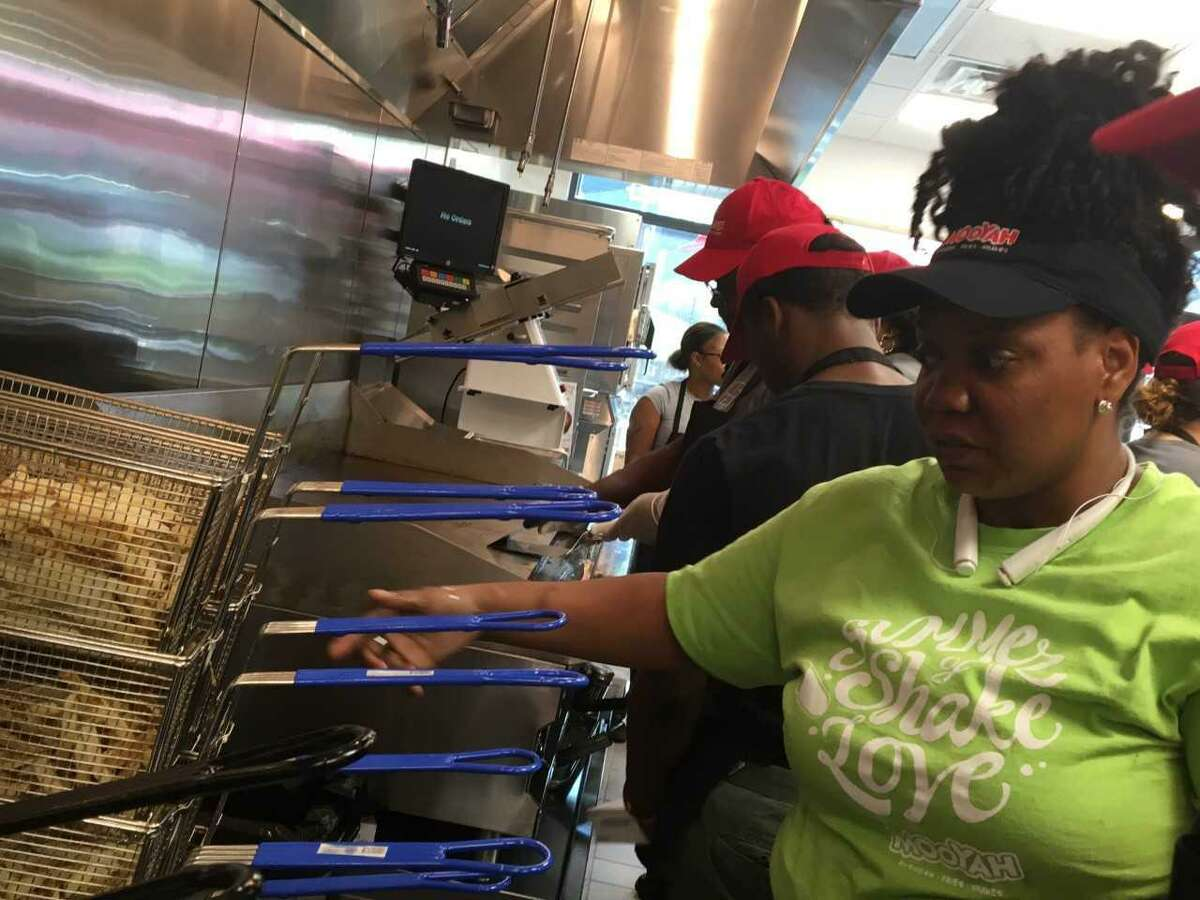 Sha'quita Jones, a Texas-based trainer for Mooyah Burgers, shows local employees the right way to do french fries during training at Mooyah's West Haven location. The location, which opened on August 24, is the latest step in the company's expansion in the Northeast. In the release, MOOYAH President, Tony Darden, said the chain plans to open five more locations in Connecticut, which would result in 125 new jobs across the state. MOOYAH currently boasts locations in West Haven, Newington, Storrs, and Guilford.