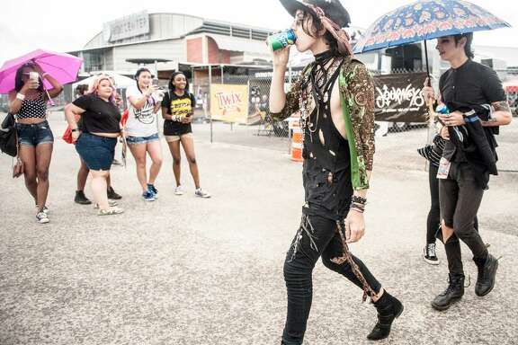 Members of the band Palaye Royale walk by fans at the 2016 Vans Warped Tour at the AT&T Center. After a 24-year run, the Vans Warped Tour will make its way around the country for the last time this year; the final stop in San Antonio is Saturday.