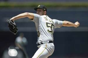 Pittsburgh Pirates starting pitcher Jameson Taillon works against a San Diego Padres batter during the first inning of a baseball game Sunday, July 1, 2018, in San Diego. (AP Photo/Gregory Bull)