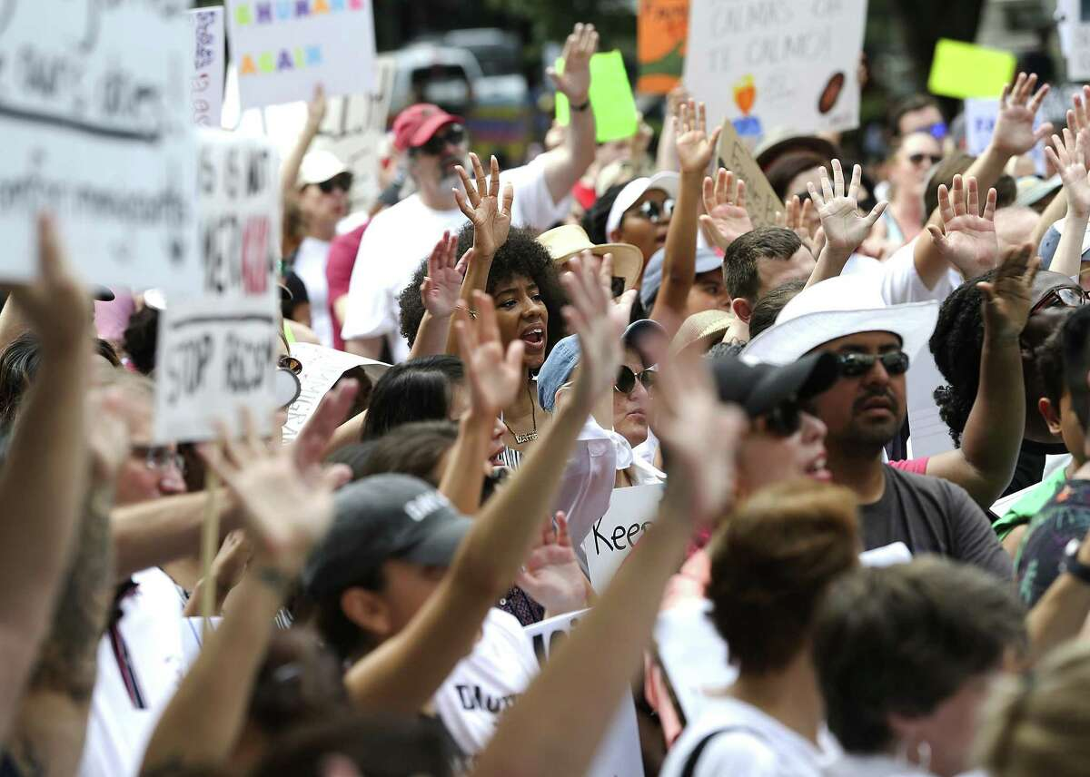 Protesters by the thousands turned out Saturday in Houston and hundreds of other U.S. cities for immigration rallies.