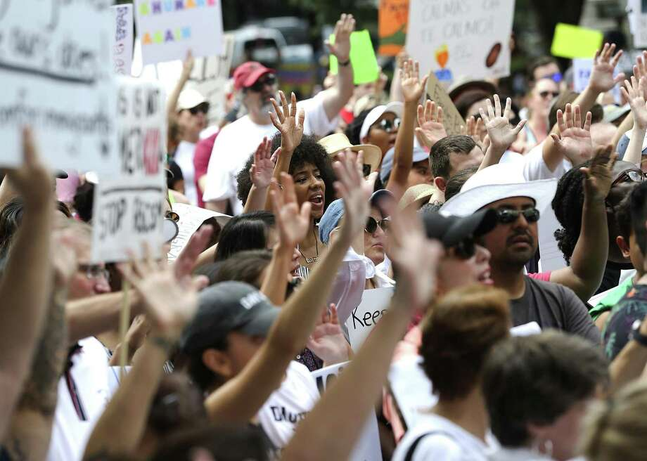 Protesters by the thousands turned out Saturday in Houston and hundreds of other U.S. cities for immigration rallies. Photo: Elizabeth Conley, MBO / Associated Press / '2018 Houston Chronicle