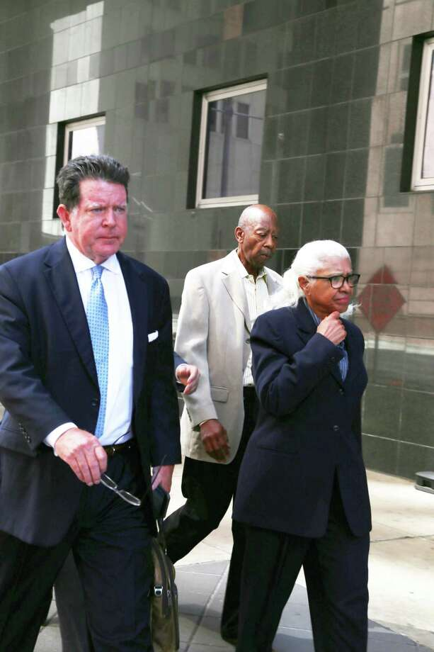 The founding superintendent of Houston's Varnett charter school, Marian Annette Cluff, and her husband, Alsie Cluff Jr., the school's former facilities manager, leave the courtroom with their attorney, Dan Cogdell. The Cuffs turned themselves into federal authorities in Houston in 2015  after being indicted on charges of embezzling more than $2.6 million intended to benefit impoverished students. Photo: Dylan Aguilar, Staff / Houston Chronicle / © 2015 Houston Chronicle