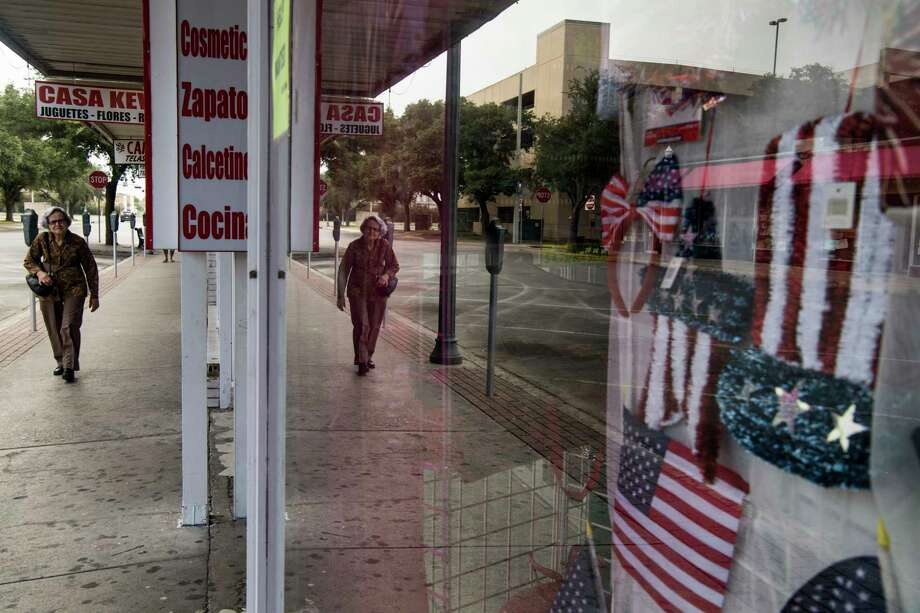 American flags hang in a shop window in McAllen, Texas, which lies on the border with Mexico. Photo: Washington Post Photo By Carolyn Van Houten / The Washington Post