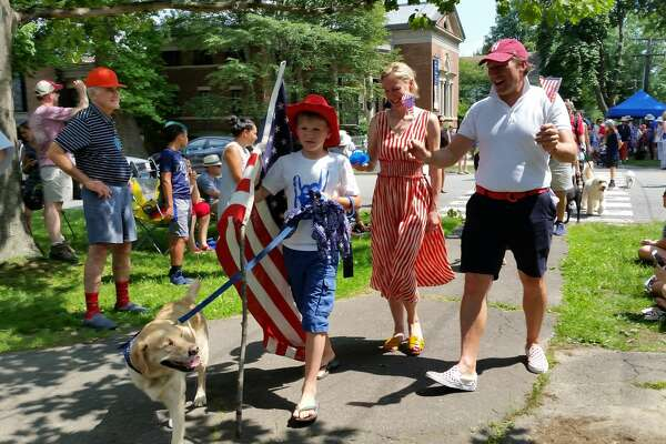 A parade of many dogs; one rabbit; one cat; five ducks; and a few stuffed animals proceeded from the front lawn of the Litchfield Historical Society Museum at 7 South Street to the Town Green across the street, consisting of about 75 pets and 300 people during the 13th annual Litchfield Historical Society's annual Fourth of July Pet Parade and Turn-of-the-Century Festival at the Litchfield Town Green on Wednesday afternoon. The 242nd-year U.S. Independence Day tradition began with the Colonial-Era-costumed First Litchfield Artillery Regiment firing of a historic cannon 13 times at 2 p.m.