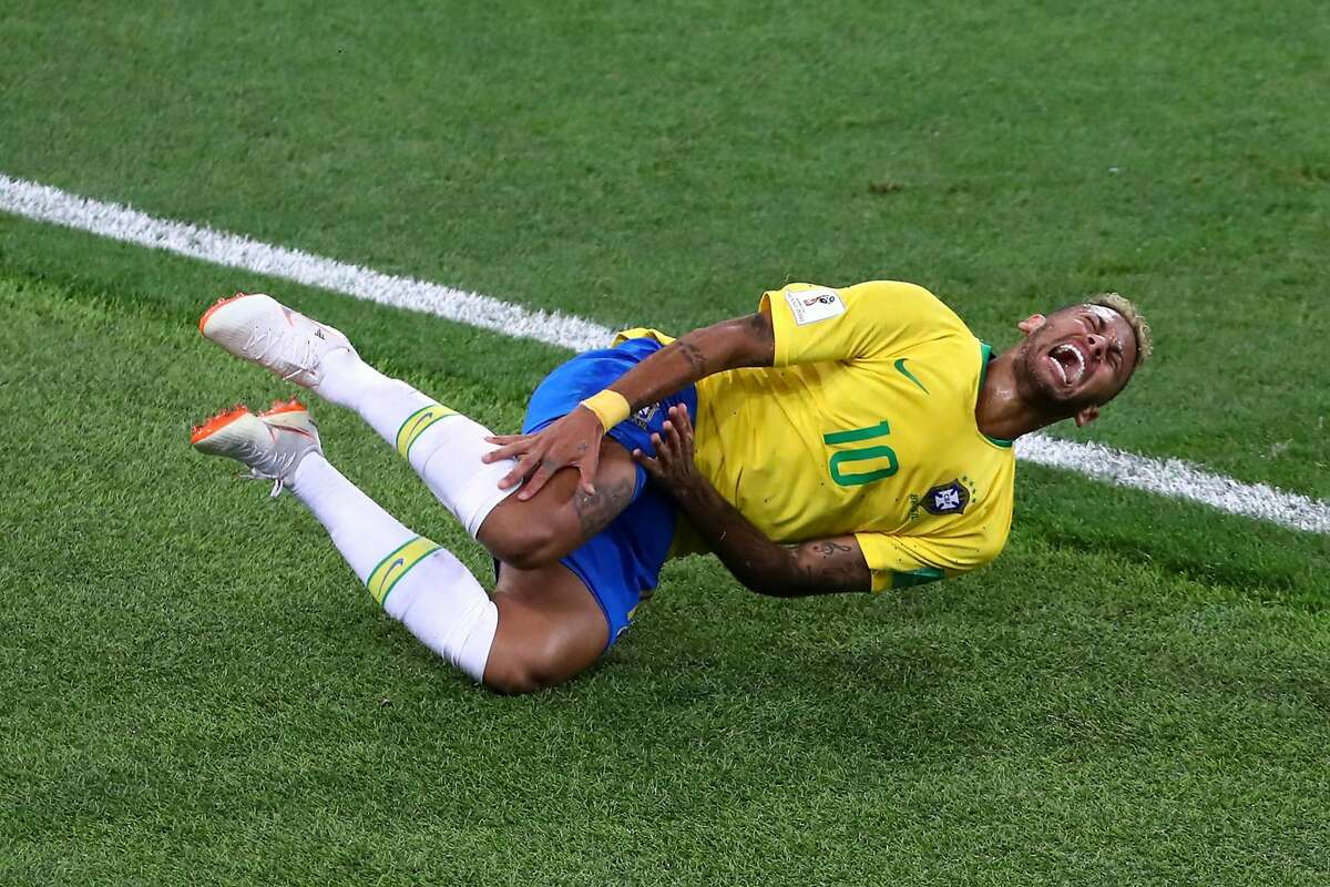 MOSCOW, RUSSIA - JUNE 27: Neymar Jr of Brazil lies on the pitch after being fouled during the 2018 FIFA World Cup Russia group E match between Serbia and Brazil at Spartak Stadium on June 27, 2018 in Moscow, Russia. (Photo by Dean Mouhtaropoulos/Getty Images)