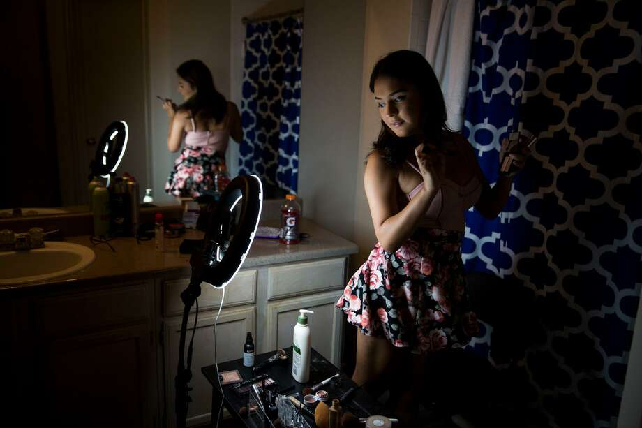 "Catizia Farris does a makeup tutorial for the ""Beauty Escape"" group on Facebook Live at her boyfriend's apartment in San Antonio on June 3, 2017. Carolyn Van Houten, former San Antonio Express-News photojournalist, has won the national 2017 Excellence in Photojournalism award from NLGJA — The Association of LGBTQ Journalists for her work on the Express-News project, ""Life in Transition."" Photo: Carolyn Van Houten /San Antonio Express-News / 2017 San Antonio Express-News"