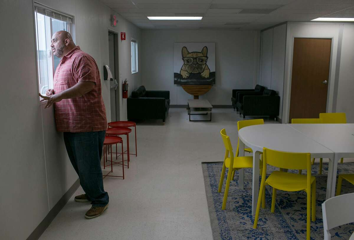 Program manager Christian Munoz shows the new recreation and learning area which is part of the city of Berkeley's new Pathways STAIR Center, the city's first navigation center for the homeless.