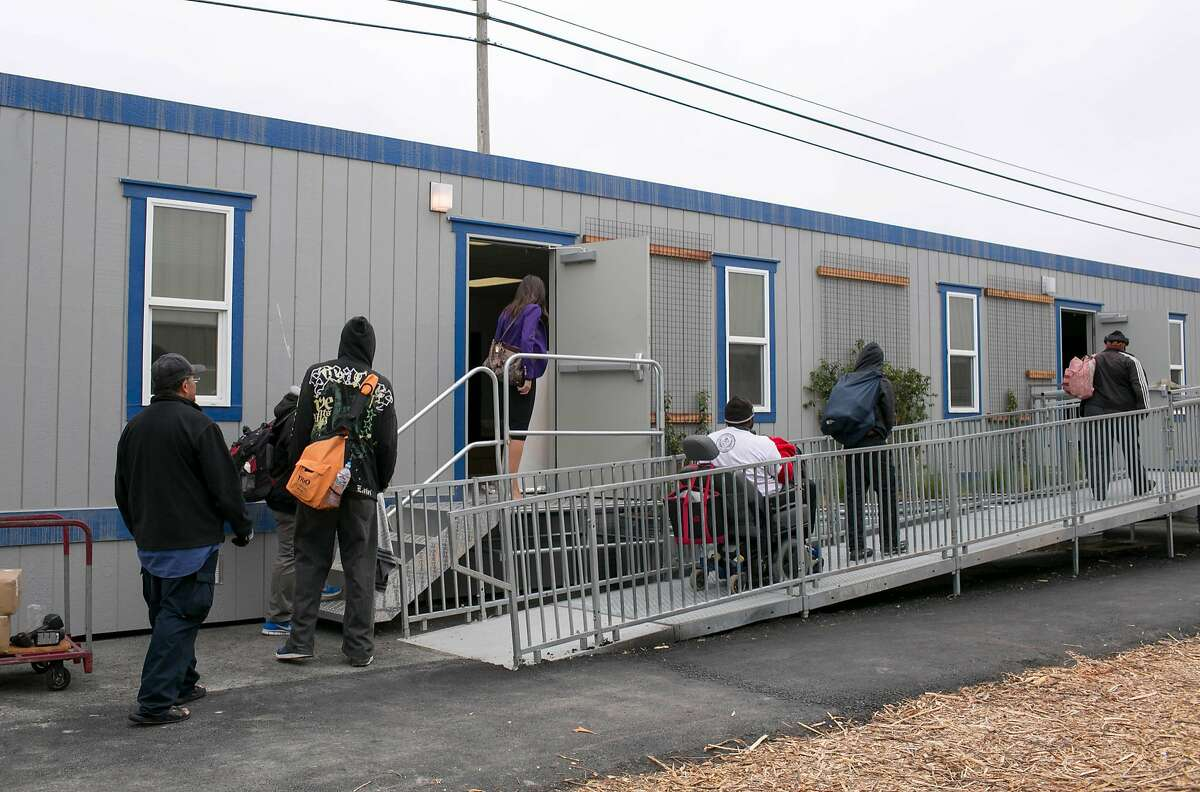 Prospective residents get a tour of the city of Berkeley's new Pathways STAIR Center, the city's first navigation center for the homeless.