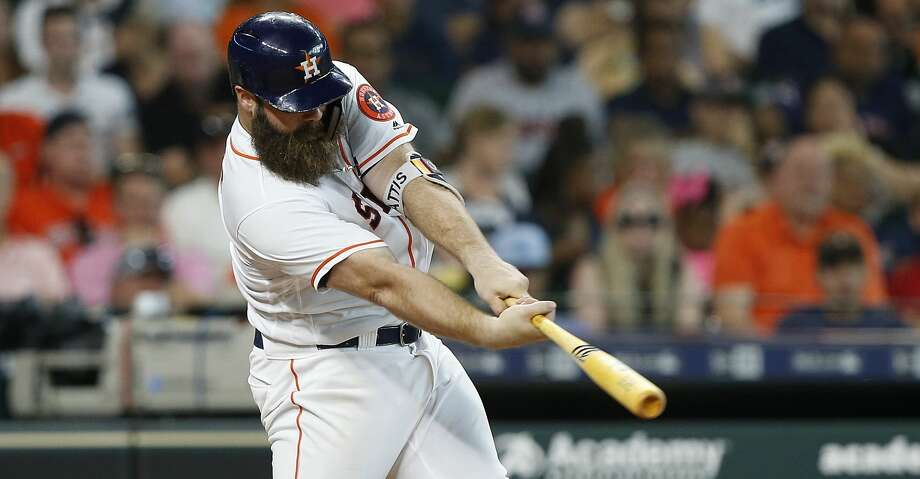 HOUSTON, TX - JUNE 27:  Evan Gattis #11 of the Houston Astros doubles in a run in the fifth inning against the Toronto Blue Jays at Minute Maid Park on June 27, 2018 in Houston, Texas.  (Photo by Bob Levey/Getty Images) Photo: Bob Levey/Getty Images