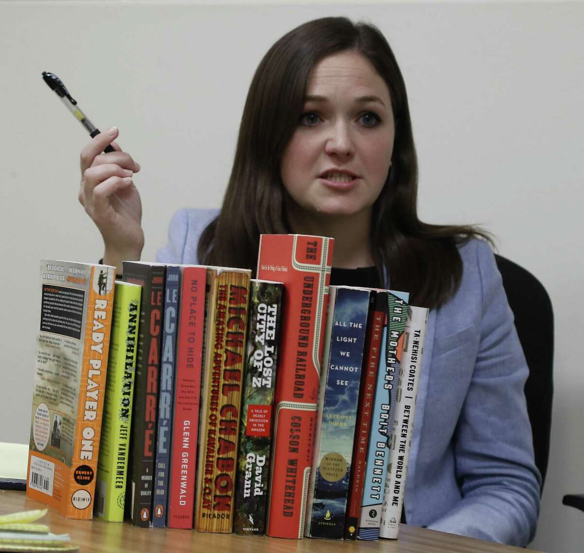 Public defender Amalia Beckner, with a few books in her personal collection, Friday, June 15, 2018, in Houston. She has been crowdfunding buying books for jailed clients in the past few weeks. ( Karen Warren / Houston Chronicle )