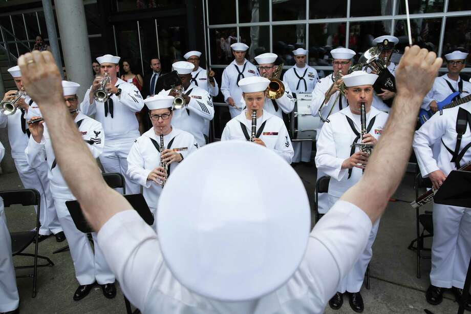 The Navy Band Northwest plays the National Anthem as 498 candidates from 84 different countries become American citizens during the Independence Day Naturalization Ceremony at Seattle Center, Wednesday, July 4, 2018. Photo: GENNA MARTIN, GENNA MARTIN, SEATTLEPI / SEATTLEPI.COM