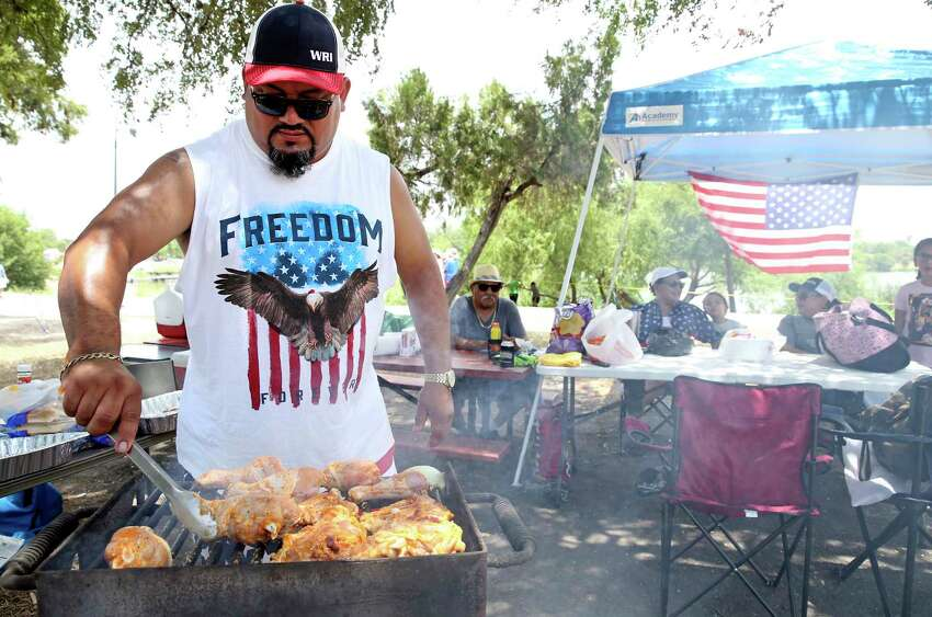 George Lopez starts the grilling for his family at the City's official Fourth of July celebration at Woodlawn Lake on July 4, 2018.