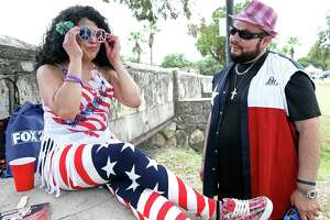 Dannette Torres adjusts her glasses with Cesar Torres admiring at the City's official Fourth of July celebration at Woodlawn Lake on July 4, 2018.